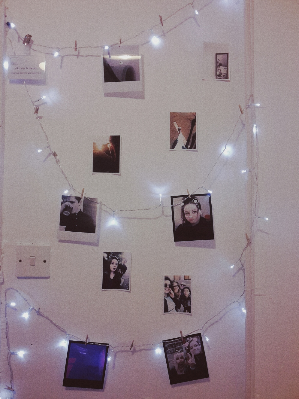 polaroid wall at night